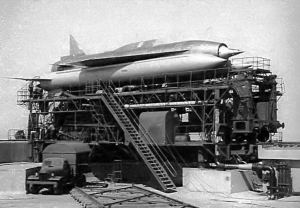 Archive black and white photo of a rocket on a launch scaffolding