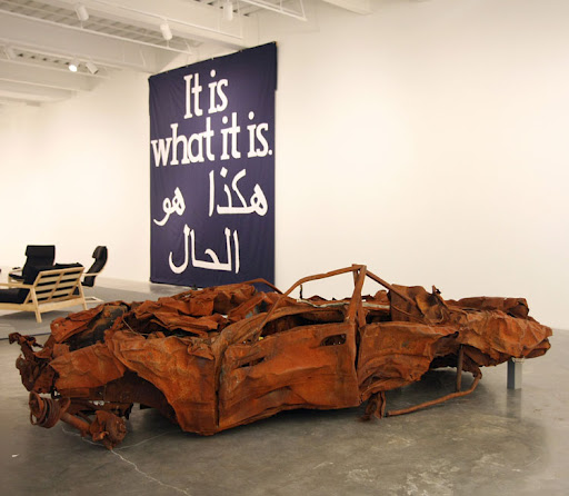 Remains of a bombed car in an art gallery