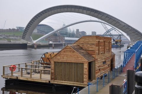 A modern wooden waterwheel and mill on the River Tyne