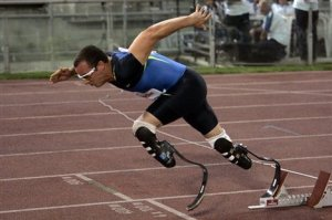 Athlete with prosthetic 'blade' legs