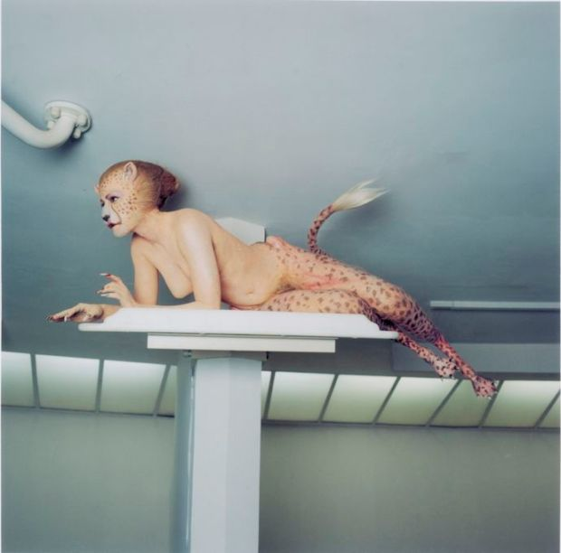 Woman as half-cheetah half-human with prosthetics legs