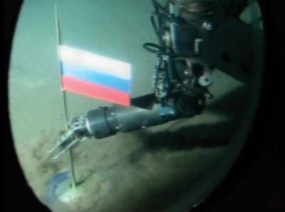 The operator of a Russian minisubmarine plants the Russian flag on the seabed at the North Pole in 2007