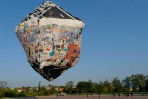 A giant balloon made of old carrier bags floats in the air