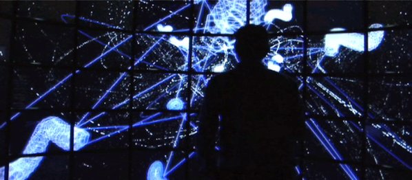 Silhouette of man in front of installation